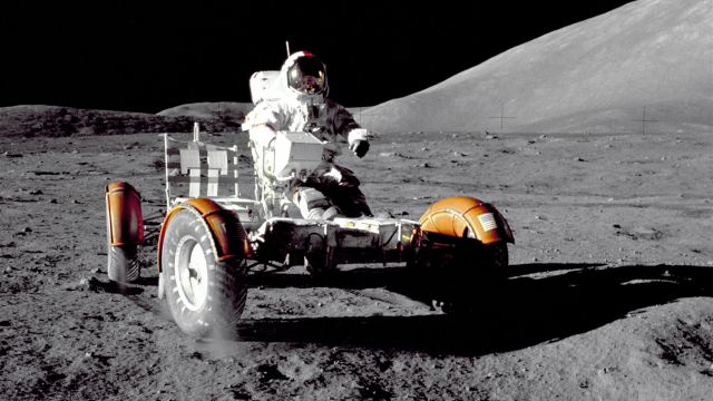 The Lunar Rover Being Driven On The Moon