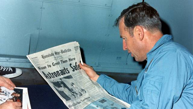 Jim Lovell Reading A Newspaper Account Of The Safe Return Of Apollo 13